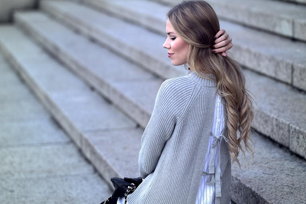 Modebloggerin-Pullover Rückenansicht-Schleifen-Hemd