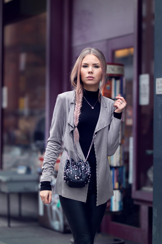 Rockiger Style-Bikerstil-Nieten-Leder-Beuteltasche-schwarze Kleidung